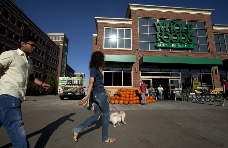 Inaam Abdul Karim (center) and Mihir Mistry (left) walk with Inaam's dog Lulu to the Whole Foods Market in Detroit, September 26th., 2014. They are both Wayne State University students.
